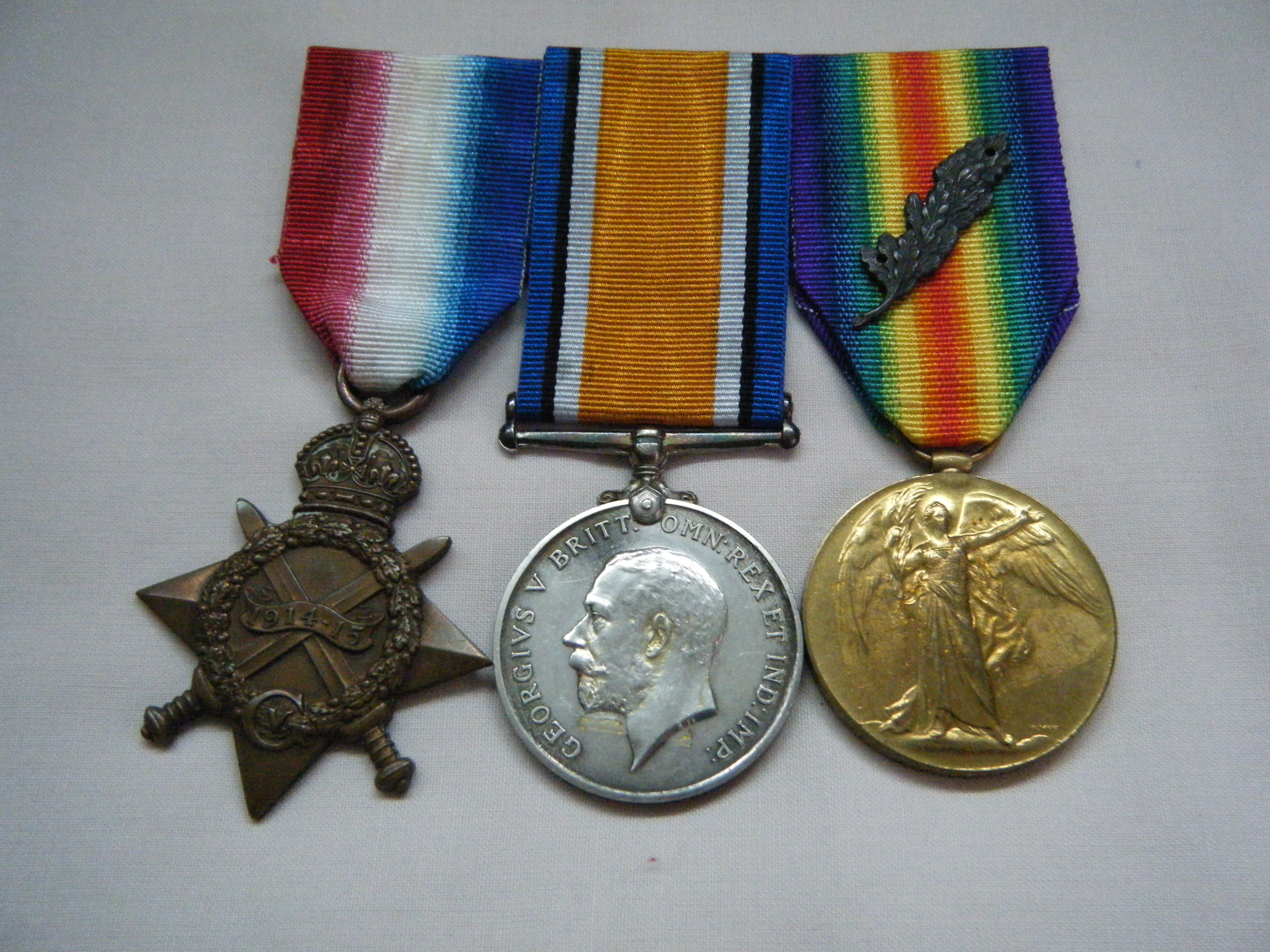 THREE.  M2-078785 Pte. W.T. Hissgen, Army Service Corps (mentioned in despatches for France on 30/12/18).