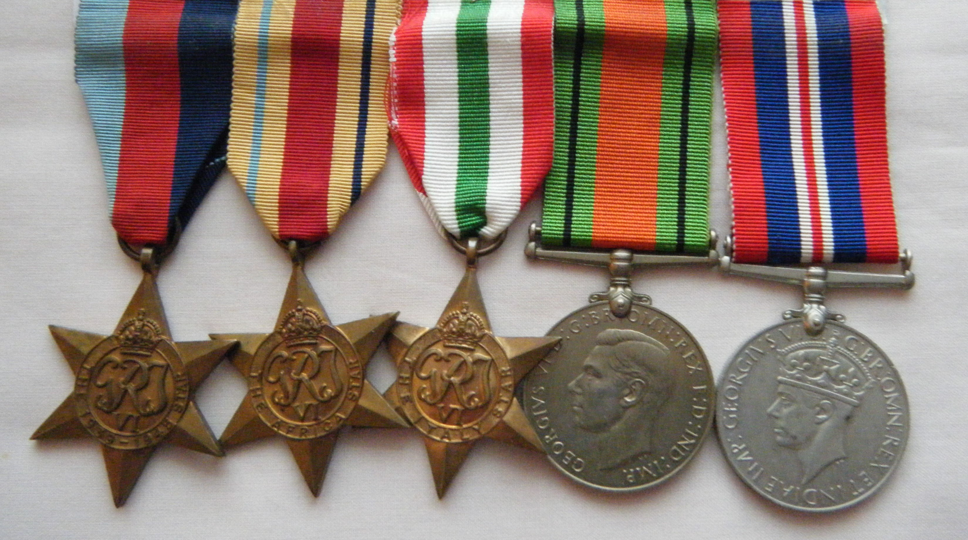 FIVE.  Gnr. S.A. Marino, Royal Artillery (wounded in action in North Africa on 23/1/41).