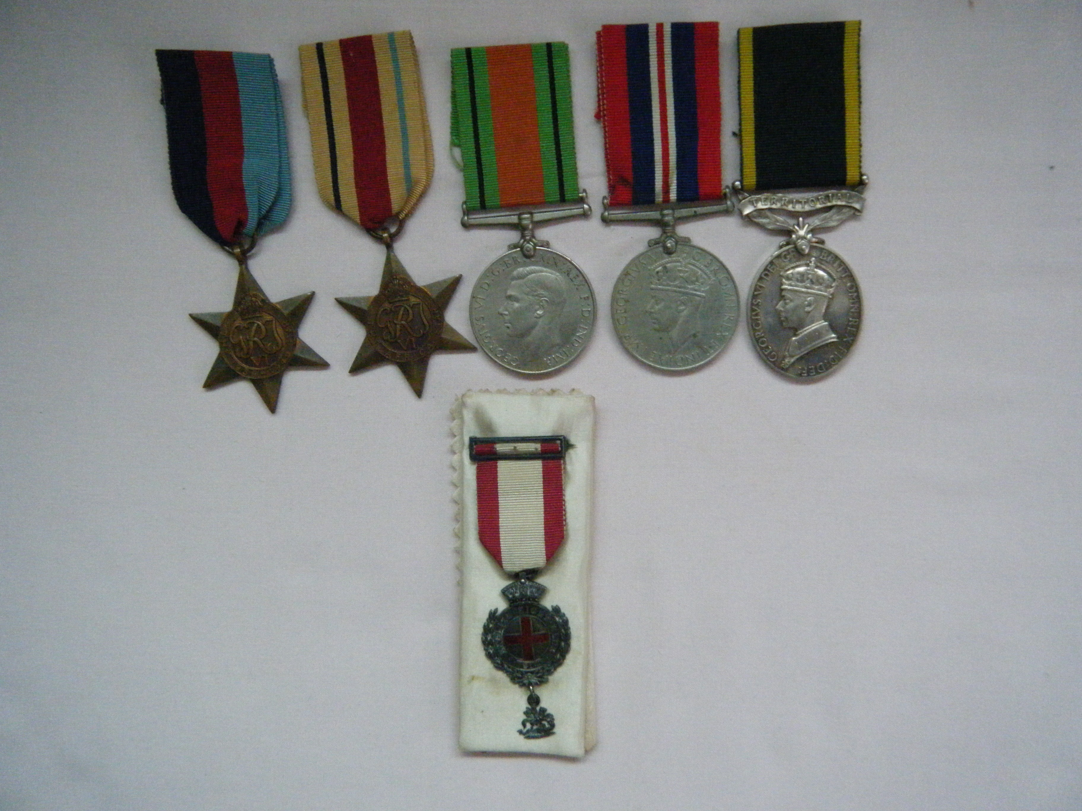 FIVE.  Lieut. A.K. Thompson, Indian Army  (with English Eight Club, Bisley, medallion).