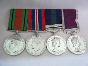 FOUR.  S./Sgt. M.P. Hunter, Women's Royal Army Corps.
