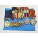 SIX.  6457959/327150  Pte. L.F. Clarke, Royal Army Ordnance Corps and South African Forces.